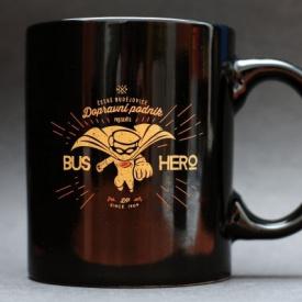 Black mug imprinted with the bus hero