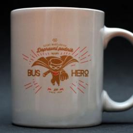 White mug imprinted with the bus hero