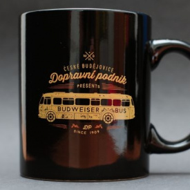 Black mug imprinted with a bus