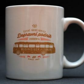 White mug imprinted with a bus